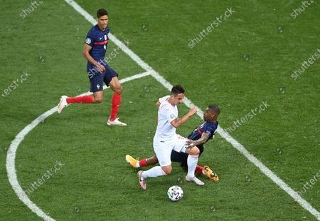 Mario Gavranovic (C) of Switzerland on his way to score his team's third goal during the UEFA EURO 2020 round of 16 soccer match between France and Switzerland in Bucharest, Romania, 28 June 2021.