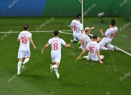 Mario Gavranovic (R) of Switzerland celebrates with teammates after scoring his team's third goal during the UEFA EURO 2020 round of 16 soccer match between France and Switzerland in Bucharest, Romania, 28 June 2021.