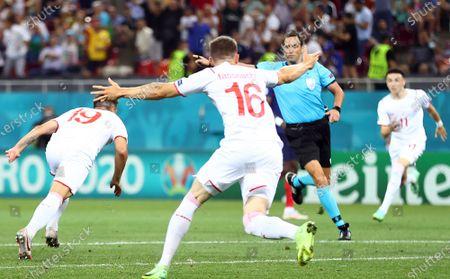 Mario Gavranovic of Switzerland (L) celebrates scoring 3-3 during the UEFA EURO 2020 round of 16 soccer match between France and Switzerland in Bucharest, Romania, 28 June 2021.