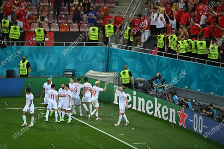 Mario Gavranovic (3-R) of Switzerland celebrates with teammates after scoring his team's third goal during the UEFA EURO 2020 round of 16 soccer match between France and Switzerland in Bucharest, Romania, 28 June 2021.