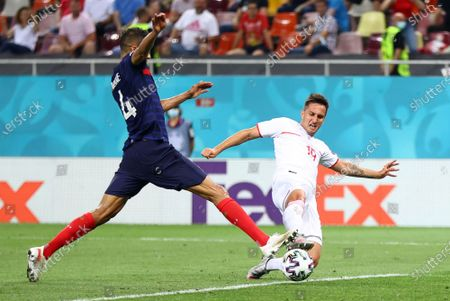 Raphael Varane of France (L) in action against Mario Gavranovic of Switzerland during the UEFA EURO 2020 round of 16 soccer match between France and Switzerland in Bucharest, Romania, 28 June 2021.