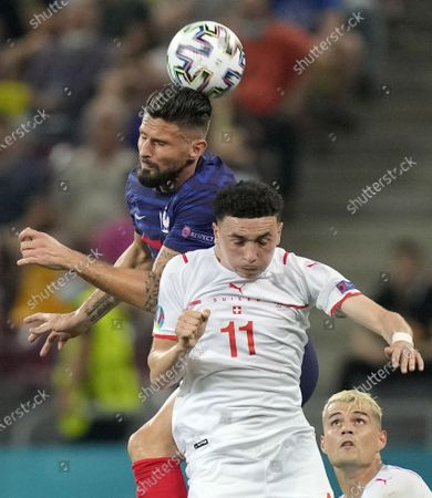 Olivier Giroud (L) of France in action against Ruben Vargas of Switzerland during the UEFA EURO 2020 round of 16 soccer match between France and Switzerland in Bucharest, Romania, 28 June 2021.