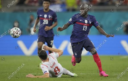 N'Golo Kante of France in action against Remo Freuler (L) of Switzerland during the UEFA EURO 2020 round of 16 soccer match between France and Switzerland in Bucharest, Romania, 28 June 2021.