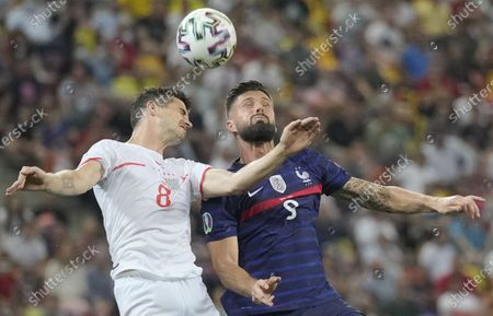 Olivier Giroud of France in action against Remo Freuler (L) of Switzerland during the UEFA EURO 2020 round of 16 soccer match between France and Switzerland in Bucharest, Romania, 28 June 2021.