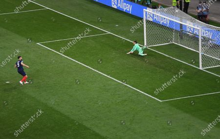 Olivier Giroud (L) of France scores on penalty during the UEFA EURO 2020 round of 16 soccer match between France and Switzerland in Bucharest, Romania, 28 June 2021.