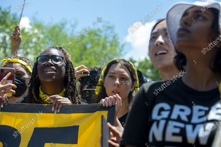 Members of The Sunrise Movement look on as Rep. Alexandria Ocasio-Cortez, D-NY, speaks during a rally held in Lafayette Square Washington, DC., on Monday, June 28, 2021. The march, which drew members from across the country, began in John Marshall Memorial Park and finished in Lafayette Square outside the White House, where members of congress, including Ocasio-Cortez, spoke to the group.