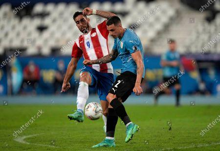 Uruguay's Jose Gimenez, right, and Paraguay's Gabriel Avalos battle for the ball during a Copa America soccer match at Nilton Santos stadium in Rio de Janeiro, Brazil