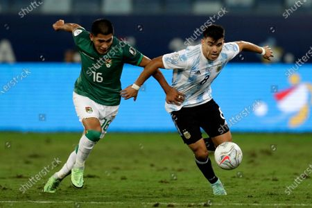 Bolivia's Erwin Saavedra, left, and Argentina's Marcos Acuna battle for the ball during a Copa America soccer match at Arena Pantanal stadium in Cuiaba, Brazil