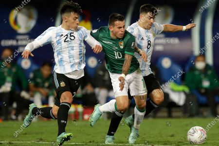 Stock Picture of Argentina's Lisandro Martinez, left, and Marcos Acuna, right, fight for the ball with Bolivia's Henry Vaca during a Copa America soccer match at Arena Pantanal stadium in Cuiaba, Brazil