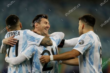 Argentina's Alejandro Gomez, center left, celebrates scoring the opening goal against Bolivia with teammates Lionel Messi, center right, Marcos Acuna, right, and Angel Correa during a Copa America soccer match at Arena Pantanal stadium in Cuiaba, Brazil