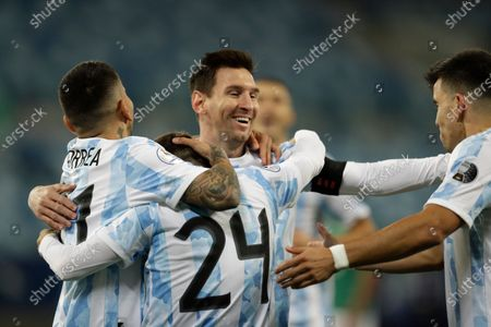 Argentina's Alejandro Gomez, 24, celebrates scoring the opening goal against Bolivia with teammates Lionel Messi, center right, Marcos Acuna, right, and Angel Correa during a Copa America soccer match at Arena Pantanal stadium in Cuiaba, Brazil