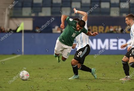 Stock Image of Argentina's Marcos Acuna in action against Bolivia's Erwin Saavedra during the Copa America group A soccer match between Bolivia and Argentina at Arena Pantanal stadium in Cuiaba, Brazil, 28 June 2021.