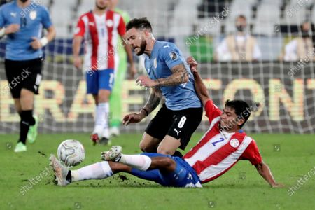 Uruguay's Nahitan Nandez (top) in action against Paraguay's Robert Rojas (bottom), during the Copa America Group A soccer match between Uruguay and Paraguay at the Nilton Santos Olympic Stadium in Rio de Janeiro, Brazil, 28 June 2021.