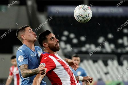 Uruguay's Jose Maria Gimenez (L) in action against Paraguay's Gabriel Avalos during the Copa America Group A soccer match between Uruguay and Paraguay at the Nilton Santos Olympic Stadium in Rio de Janeiro, Brazil, 28 June 2021.