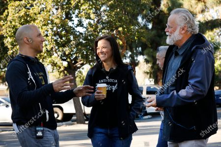 """Stock Photo of LOS ANGELES, CA - OCTOBER 16, 2018 - Author Michael Connelly, right, with Los Angeles Police Department (LAPD) Detective Mitzi Roberts, middle, and Tom Bernardo, Supervising Producer and Writer, left, on the film set shooting of """"Bosch"""" Season 5 in the San Fernando Valley on October 16, 2018. Detective Mitzi Roberts, is the inspiration of Connelly's new character in the show, Renee Ballard. (Al Seib / Los Angeles Times)"""