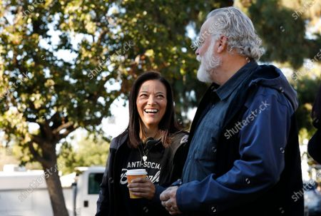 """LOS ANGELES, CA - OCTOBER 16, 2018 - Author Michael Connelly, right, with Los Angeles Police Department (LAPD) Detective Mitzi Roberts on the film set shooting of """"Bosch"""" Season 5 in the San Fernando Valley on October 16, 2018. Detective Mitzi Roberts, is the inspiration of Connelly's new character in the show, Renee Ballard. (Al Seib / Los Angeles Times)"""