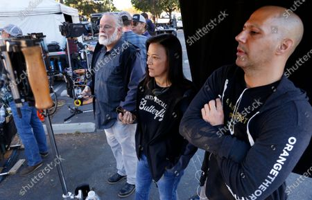 """Stock Picture of LOS ANGELES, CA - OCTOBER 16, 2018 - Author Michael Connelly, Los Angeles Police Department (LAPD) Detective Mitzi Roberts, and Tom Bernardo, Supervising Producer and Writer, left to right, on the film set shooting of """"Bosch"""" Season 5 in the San Fernando Valley on October 16, 2018. Detective Mitzi Roberts, is the inspiration of Connelly's new character in the show, Renee Ballard. (Al Seib / Los Angeles Times)"""