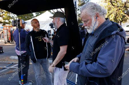 """Stock Image of LOS ANGELES, CA - OCTOBER 16, 2018 - Author Michael Connelly, right, with Executive Producer Henrik Bastin, middle, and Tom Bernardo, left, Supervising Producer and Writer on the film set shooting of """"Bosch"""" Season 5 in the San Fernando Valley on October 16, 2018. Actress Jacqueline Obradors plays the part of Detective Renee Ballard based on Los Angeles Police (LAPD) Detective Mitzi Roberts and is the inspiration of Connelly's new character in the show. (Al Seib / Los Angeles Times)"""