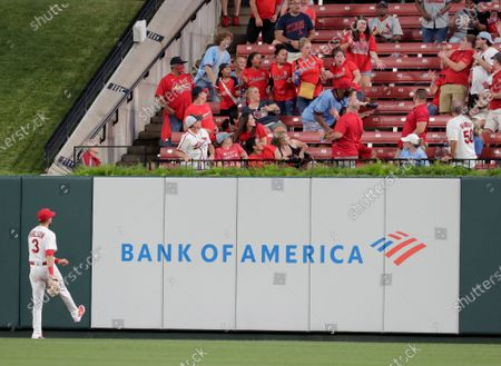 Stock Photo of St. Louis Cardinals' Dylan Carlson (3) watches the home run ball hit by Arizona Diamondbacks' Josh Rojas fly into the stands in the fifth inning of a baseball game, in St. Louis