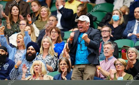 Stock Photo of John Bercow watching Roger Federer on Centre Court