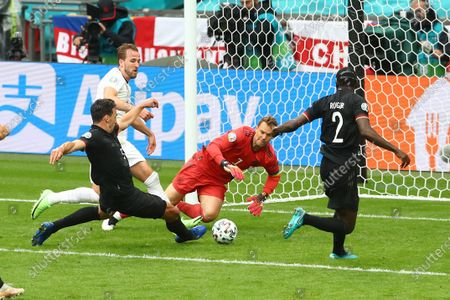 Harry Kane of England has a chance on goal in the last few minutes of the first half as Mats Hummels of Germany makes a clearance.