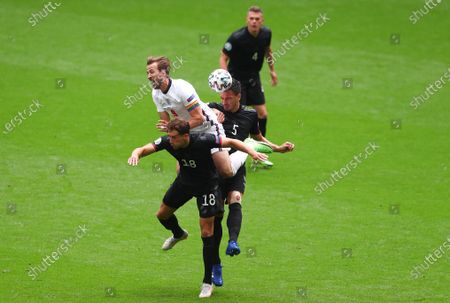 Stock Image of Harry Kane of England is sandwiched between Leon Goretzka of Germany and Mats Hummels of Germany