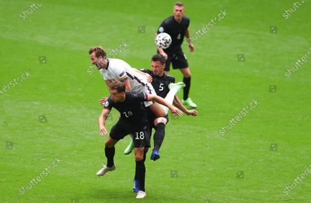 Stock Photo of Harry Kane of England is sandwiched between Leon Goretzka of Germany and Mats Hummels of Germany