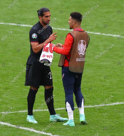 Borussia Dortmund team mates Emre Can of Germany and Jadon Sancho of England speak at full time