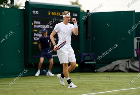 Canada's Denis Shapovalov celebrates winning a point against Germany's Philipp Kohlschreiber during the men's singles first round match on day two of the Wimbledon Tennis Championships in London