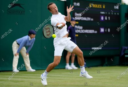 Germany's Philipp Kohlschreiber plays a return to Canada's Denis Shapovalov during the men's singles first round match on day two of the Wimbledon Tennis Championships in London