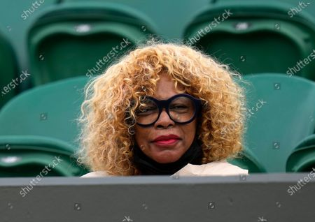 Oracene Price, mother of Venus Williams of the US watches the women's singles first round match against Romania's Mihaela Buzarnescu on day two of the Wimbledon Tennis Championships in London