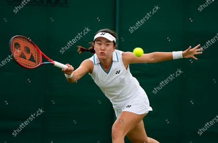 China's Lin Zhu plays a return to Germany's Mona Barthel during the women's singles first round match on day two of the Wimbledon Tennis Championships in London