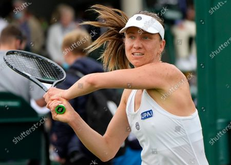 Germany's Mona Barthel plays a return to China's Lin Zhu during the women's singles first round match on day two of the Wimbledon Tennis Championships in London
