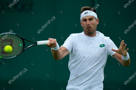 Slovakia's Norbert Gombos plays a return to Tennys Sandgren of the US during the men's singles first round match on day two of the Wimbledon Tennis Championships in London