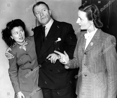 Tommy Handley British Comedian Mainly Known For The Bbc Radio Programme Itma ('it's That Man Again'). Thomas Reginaldd 'tommy' Handley. Thomas Reginald Handley . Seen Here With Molly Weir Left Also Spelt Molly Wier And Joan Harben Right.