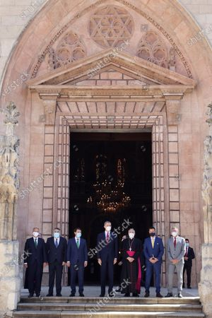 Stock Photo of Spain's King Felipe VI (C) poses with Castille and Leon's regional President Alfonso Fernandez Manueco (C-L), Spanish Culture Minister Jose Manuel Rodriguez Uribes (2L), Burgos' bishop Mario Iceta (3R), Spanish Government's delegate in Castille and Leon Javier Izquierdo (R) and other authorities on the occasion of the opening ceremony of 'Las Edades del Hombre' ('Ages of Mankind') exhibition at Burgos' cathedral in Burgos, central Spain, 29 June 2021. The exhibition marks the 800th anniversary of the cathedral's construction.