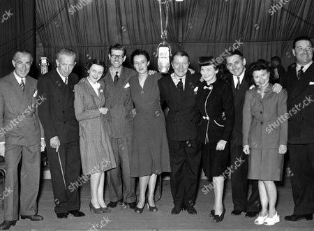 Tommy Handley British Comedian Mainly Known For The Bbc Radio Programme Itma ('it's That Man Again'). Thomas Reginaldd 'tommy' Handley. Thomas Reginald Handley . Seen With The Cast Of Itma L-r 1st L ? 2nd L ? 3rd. L Joan Harben Derek Guyler Diana Morrision Tommy Handley 7th. ? 8th. ? 9th. Molly Weir 10th. ?