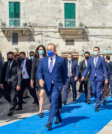 Turkey's Minister of Foreign Affairs Mevlut Cavusoglu (C) arrives for a G20 Foreign and Development Ministers' meeting in Matera, southern Italy, 29 June 2021.