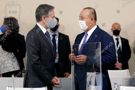 US Secretary of State Antony Blinken (L) with Turkey's Minister of Foreign Affairs Mevlut Cavusoglu (R) at the start of a G20 Foreign and Development Ministers' meeting in Matera, southern Italy, 29 June 2021.