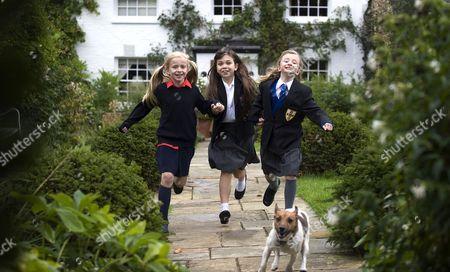 Adrianna Bertola, Josie Griffithsand Kerry Ingram with Pesto the dog