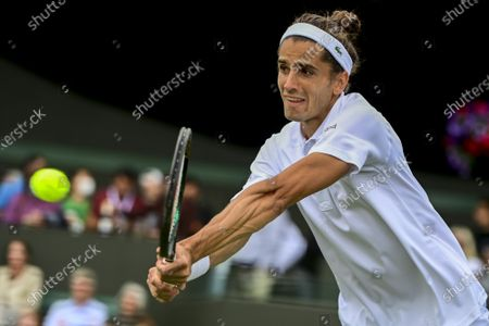 Pierre-Hugues Herbert of France in action against Pablo Andujar of Spain during the 1st round match at the Wimbledon Championships, Wimbledon, Britain 29 June 2021.