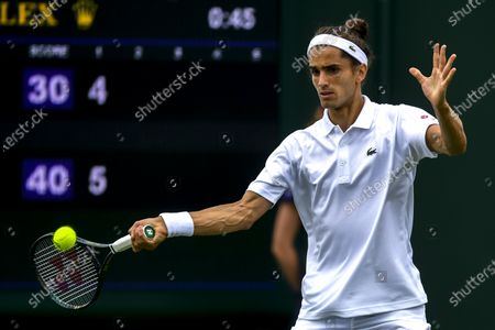 Stock Photo of Pierre-Hugues Herbert of France in action against Pablo Andujar of Spain during the 1st round match at the Wimbledon Championships, Wimbledon, Britain 29 June 2021.