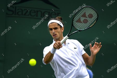 Stock Picture of Pierre-Hugues Herbert of France in action against Pablo Andujar of Spain during the 1st round match at the Wimbledon Championships, Wimbledon, Britain 29 June 2021.