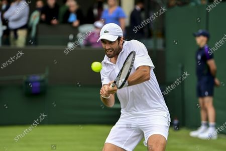 Pablo Andujar of Spain in action against Pierre-Hugues Herbert of France during the 1st round match at the Wimbledon Championships, Wimbledon, Britain, 29 June 2021.