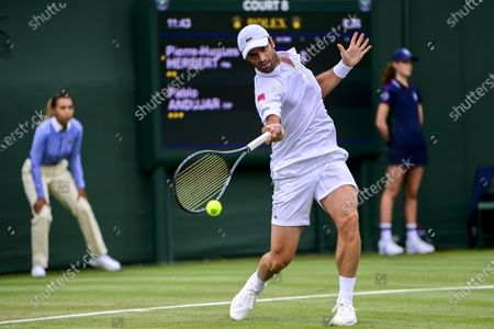 Stock Image of Pablo Andujar of Spain in action against Pierre-Hugues Herbert of France during the 1st round match at the Wimbledon Championships, Wimbledon, Britain, 29 June 2021.