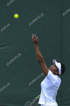Venus Williams of the USA in action against Mihaela Buzarnescu of Romania during their 1st round match at the Wimbledon Championships, Wimbledon, Britain 29 June 2021.