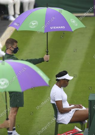 Venus Williams of the USA between games against Mihaela Buzarnescu of Romania during their 1st round match at the Wimbledon Championships, Wimbledon, Britain 29 June 2021.