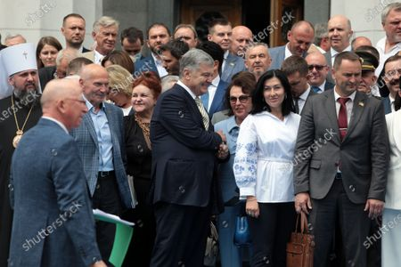 Former President of Ukraine Petro Poroshenko (C) is pictured outside the Ukrainian parliament building following the solemn meeting dedicated to the 25th anniversary of the adoption of the Constitution of Ukraine, Kyiv, capital of Ukraine.