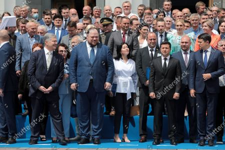 Stock Picture of Former President of Ukraine Petro Poroshenko, First Deputy Speaker Ruslan Stefanchuk, President of Ukraine Volodymyr Zelenskyy and Speaker Dmytro Razumkov (L to R, front) pose for a group photo outside the Ukrainian parliament building after the solemn meeting dedicated to the 25th anniversary of the adoption of the Constitution of Ukraine, Kyiv, capital of Ukraine.