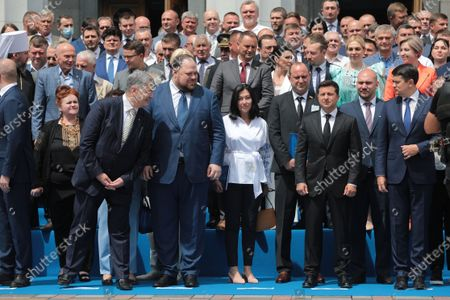 Stock Image of Former President of Ukraine Petro Poroshenko, First Deputy Speaker Ruslan Stefanchuk, President of Ukraine Volodymyr Zelenskyy and Speaker Dmytro Razumkov (L to R, front) pose for a group photo outside the Ukrainian parliament building after the solemn meeting dedicated to the 25th anniversary of the adoption of the Constitution of Ukraine, Kyiv, capital of Ukraine.
